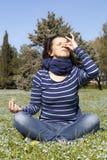 Mid aged woman doing yoga pranajama exercises outside Royalty Free Stock Photos