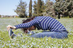 Mid aged woman doing yoga exercises outside Royalty Free Stock Photography