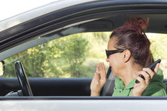 Mid aged woman sneeze in the car Royalty Free Stock Photos