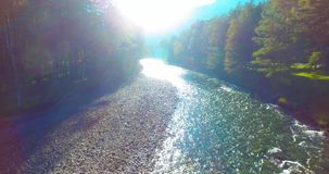 Mid air flight over fresh and clean mountain river at sunny summer morning. Aerial UHD 4K view. Mid-air flight over fresh and clean mountain river at sunny stock video footage