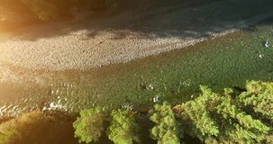 Mid air flight over fresh and clean mountain river at sunny summer morning. Vertical movement. Aerial UHD 4K view. Mid-air flight over fresh and clean mountain stock footage