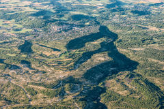 Mid-air view of green hills and cultivated land near Forcalquier Royalty Free Stock Images