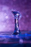 Mid air water drop and splash collision Royalty Free Stock Photos