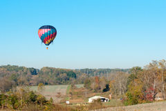 Mid air zen. Hot air baloon floating in october at statesville nc, north carolina over farm land stock image