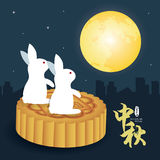 Mid-autumn festival illustration of bunny sitting at moon cakes looking the full moon. Caption: Mid-autumn festival, 15th august Stock Photography