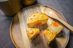 Moon cake on wooden plate Royalty Free Stock Images