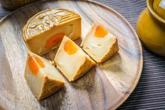 Moon cake on wooden plate Stock Photos