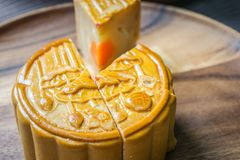 Moon cake on wooden plate Stock Photography