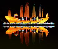 Mid Autumn Lantern Reflection. Giant lanterns in celebration of Mid Autumn Festival floating in the lake of Gardens by the Bay, Singapore Stock Photography