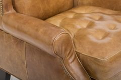 Mid-Century Leather Recliner, In top-grain leather, our Rhys Mid-Century Recliner, Solid wood legs in a Pecan finish. stock images