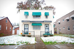 Mid-Century Modern Duplex. Mid-Century Modern style duplex home with snow on the lawn Stock Image