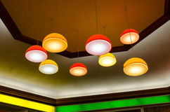 Mid-century pendant lamps in mall. Mid-century (60s or 70s) pendant lamps haging off the ceiling in an urban mall Stock Images