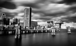 Mid-day long exposure of the Baltimore Inner Harbor Skyline.  royalty free stock photos
