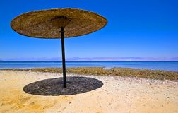 Mid Day Shade. Canopy\parasol\umbrella shade on sandy beach against a blue sky Stock Images
