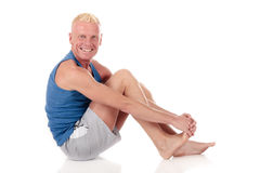 Mid forties man fitness. Mid forties blond male working out, fitness, studio shot, white background Royalty Free Stock Images