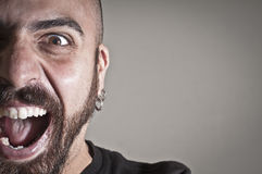Mid-frontal portrait of a man yelling Royalty Free Stock Photography