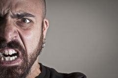 Mid-frontal portrait of a man yelling Royalty Free Stock Images