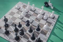 Figures on the chessboard. Mid-game, the parties made their moves. On a chessboard a difficult situation, exact calculation, analysis is necessary. Meditation Royalty Free Stock Photos