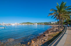 Mid morning sunny walk along Ibiza waterfront.  Warm day on the beach in St Antoni de Portmany Balearic Islands, Spain Stock Photos