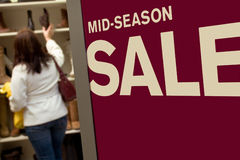 Mid-Season Sale. Woman shopping for shoes during a mid-season sale Royalty Free Stock Photography