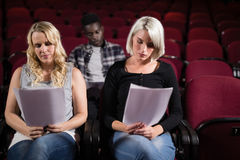 Actors reading their scripts on stage in theatre Stock Photography