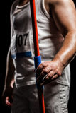 Mid section of athlete standing with javelin Stock Image