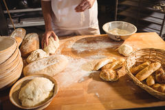 Mid-section of baker ready to knead a dough Stock Photo