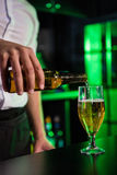 Mid section of bartender pouring beer in a glass Royalty Free Stock Images