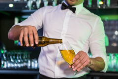 Mid section of bartender pouring beer in a glass Royalty Free Stock Photography