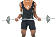 Mid-section of bodybuilder lifting heavy barbell weights Royalty Free Stock Image