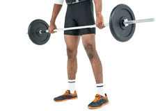 Mid-section of bodybuilder lifting heavy barbell weights Royalty Free Stock Photo