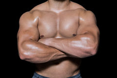 Mid section of a bodybuilder man with arms crossed Stock Image