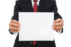 Mid section of a business man with an empty paper Royalty Free Stock Photography