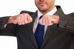 Mid section of a businessman with clenched fist Stock Photos