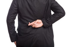 Mid section of a businessman with crossed fingers. Over white background Royalty Free Stock Image