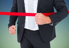 Mid section of businessman crossing the finish line Stock Photography