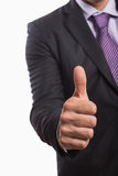 Mid section of a businessman gesturing thumbs up Royalty Free Stock Photography