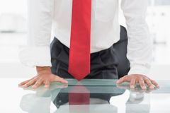 Mid section of a businessman with hands on desk Royalty Free Stock Photos