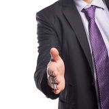 Mid section of businessman offering a handshake Stock Images