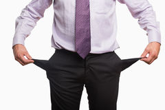 Mid section of a businessman with pockets pulled out Stock Photo