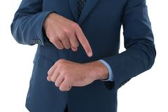 Mid section of businessman pointing on invisible wrist watch Stock Photography