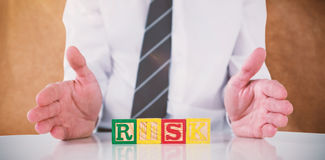 Composite image of mid section of businessman with risk text Stock Photography