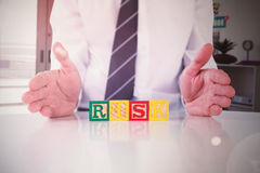 Composite image of mid section of businessman with risk text Stock Photos