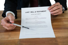Mid section of businessman showing last will and testament form Royalty Free Stock Photography