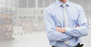 Mid section of businessman standing with arms crossed Stock Photo
