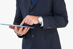 Mid section of a businessman touching tablet Stock Photo