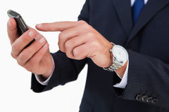 Mid section of a businessman typing on his phone Stock Image