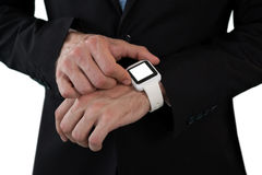 Mid section of businessman using smart watch Royalty Free Stock Photos