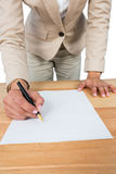 Mid section of businesswoman filling mortgage contract form Royalty Free Stock Images