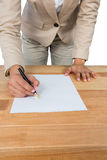Mid section of businesswoman filling mortgage contract form Royalty Free Stock Photo